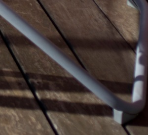 The structure of a deck chair in the bottom right corners appears slightly soft with the Zeiss ZM Biogon 25 on the Sony NEX-5N