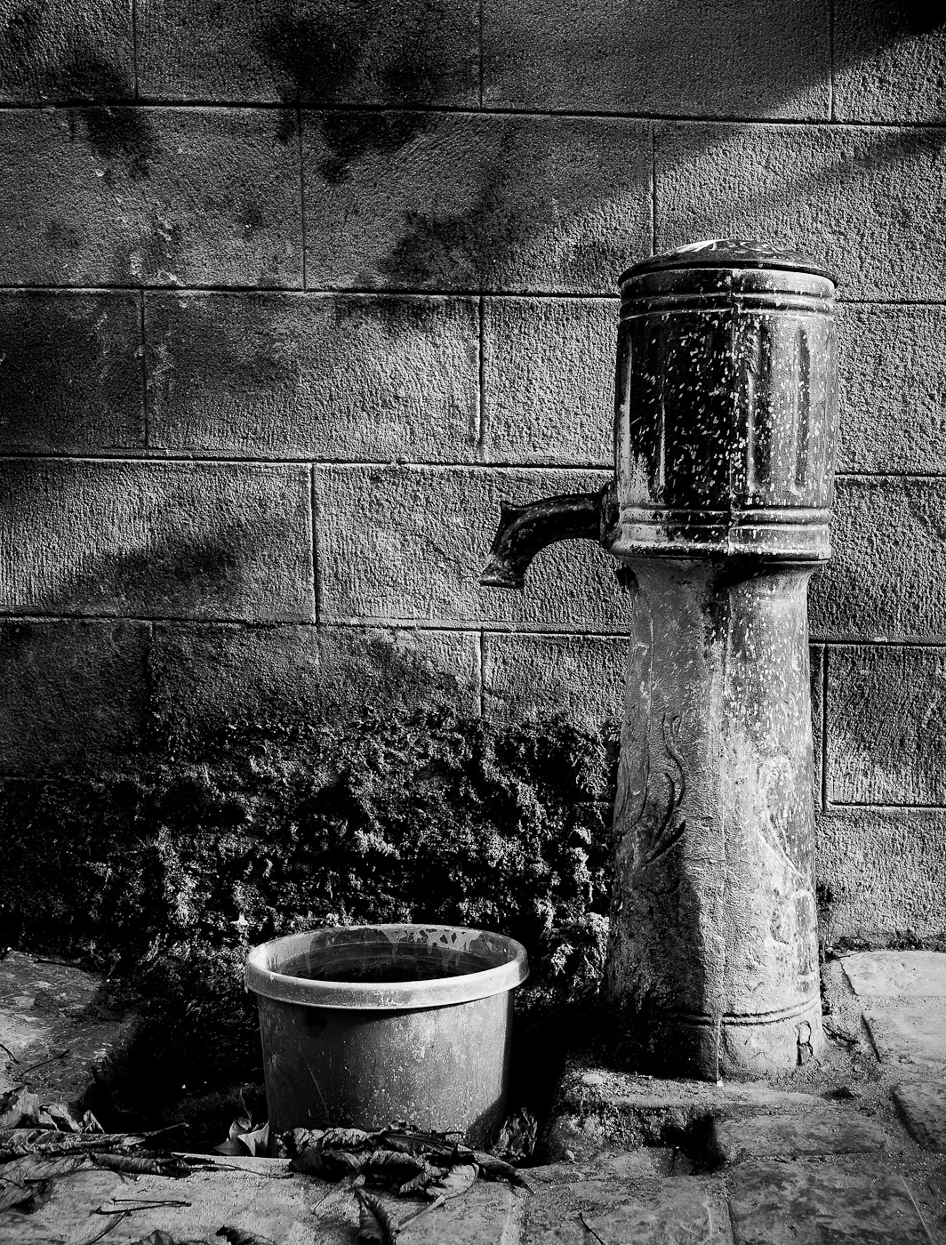 A village fountain shot in B&W