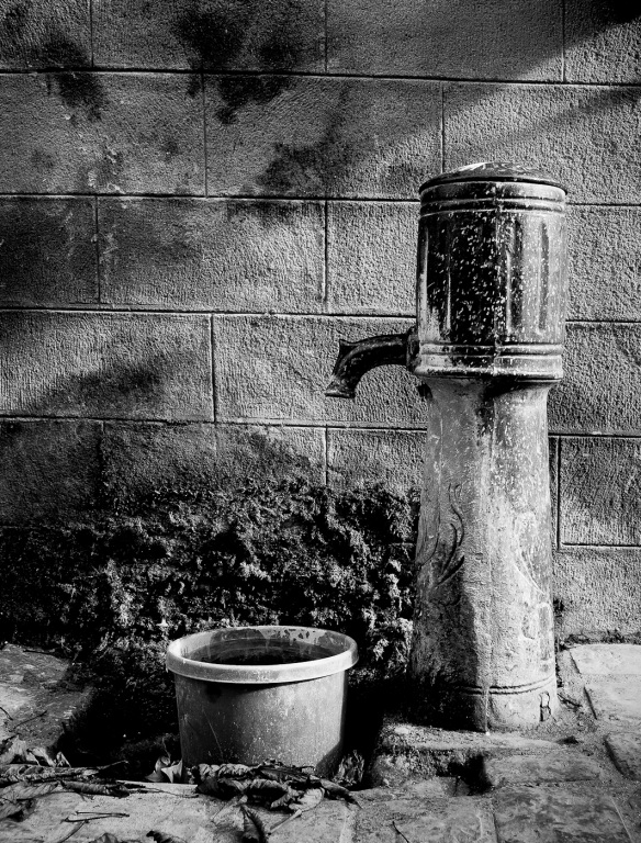 A village fountain shot in B&W