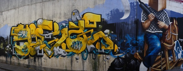 A yellow and blue graffito. Panorama using the Sony NEX-5N and