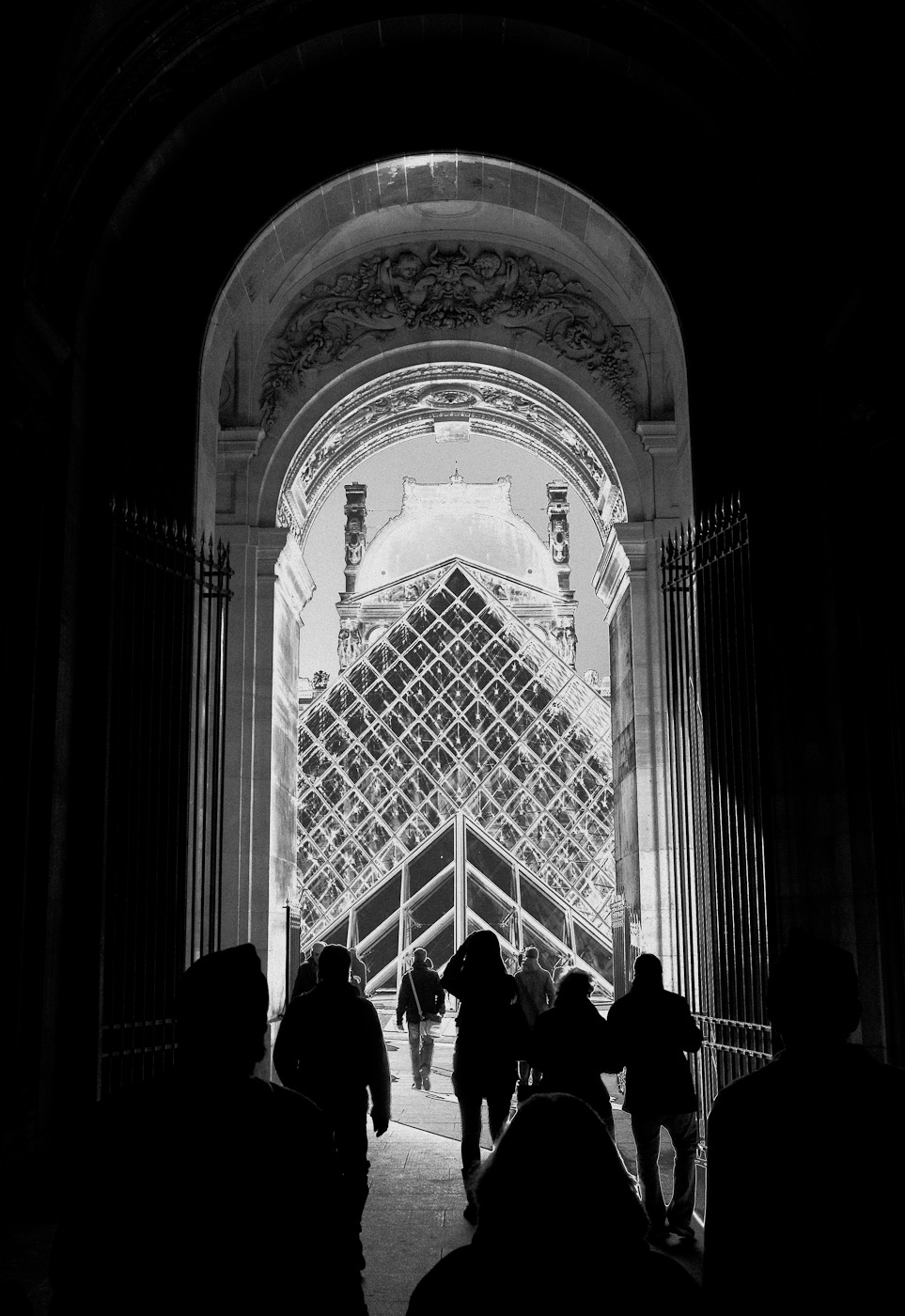 The passage towards the Louvre glass pyramid, solarized. Zeiss Biogon ZM 25/2.8 on SOny NEX-5n