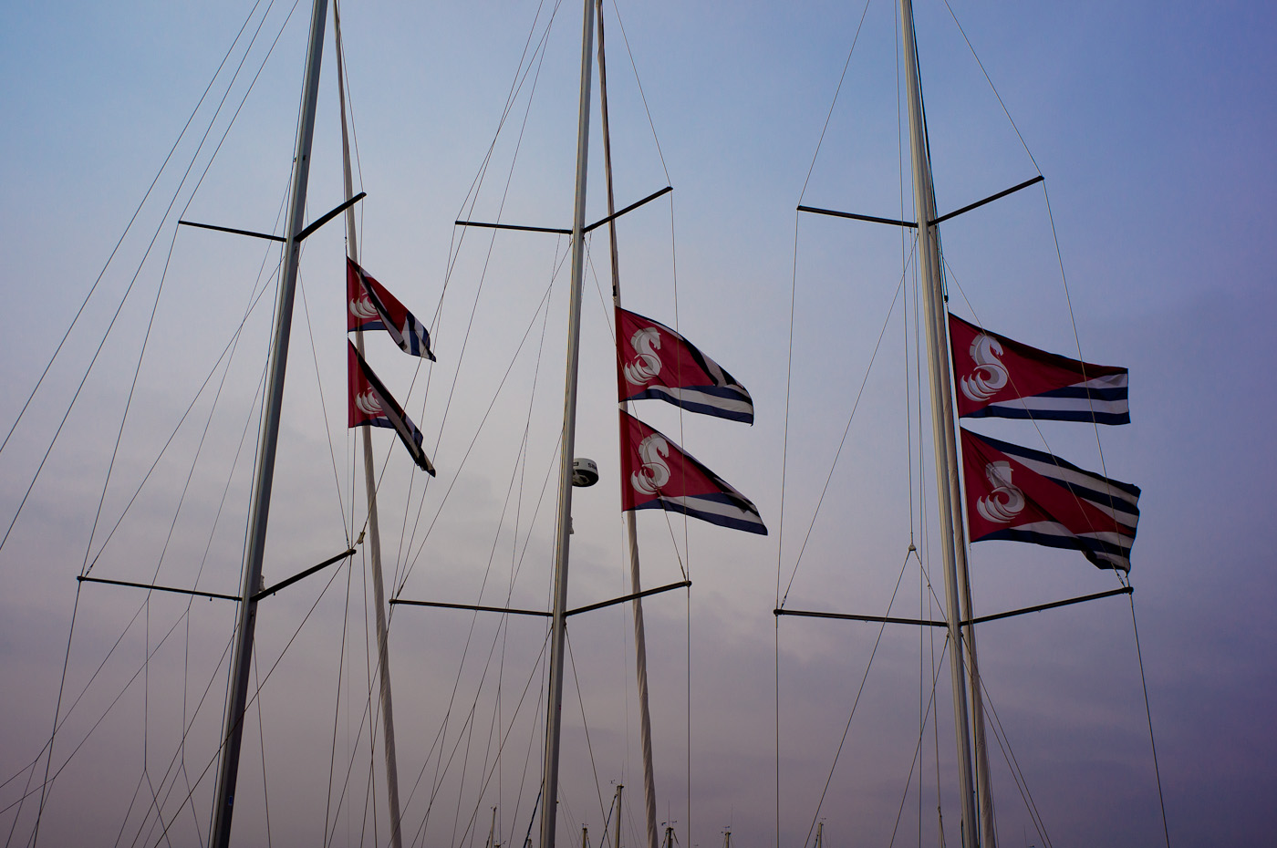 Red flags on sail boast in La Ciotat harbour