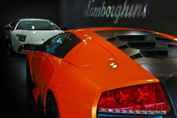 A white lamborghini faces an orange lamborghini. Sony NEX-5n