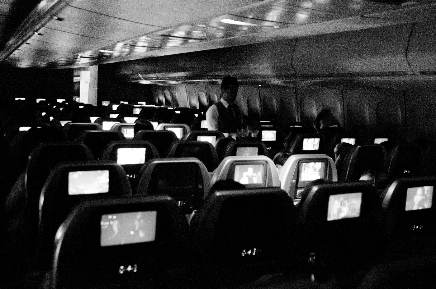 A very gritty but beautiful picture inside a commercial flight at 25600ISO. Sony NEX-5n