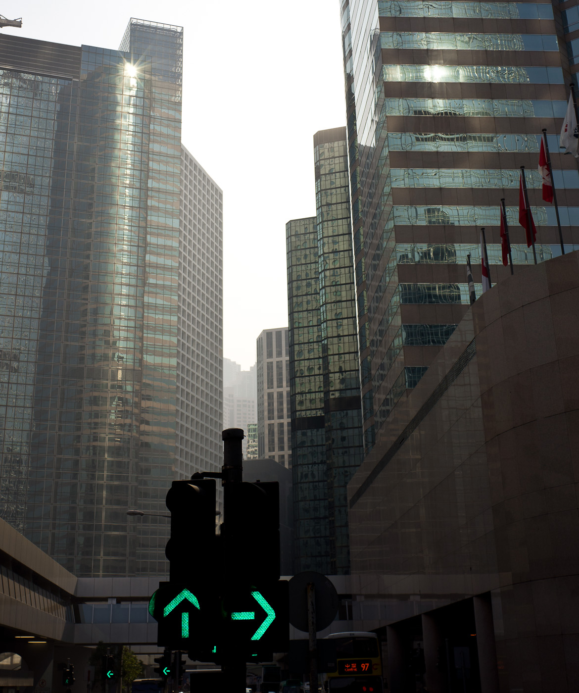 A set of trafic lights among very high buildings in Hong-Kong. Sony NEX-5n, Biogon 25