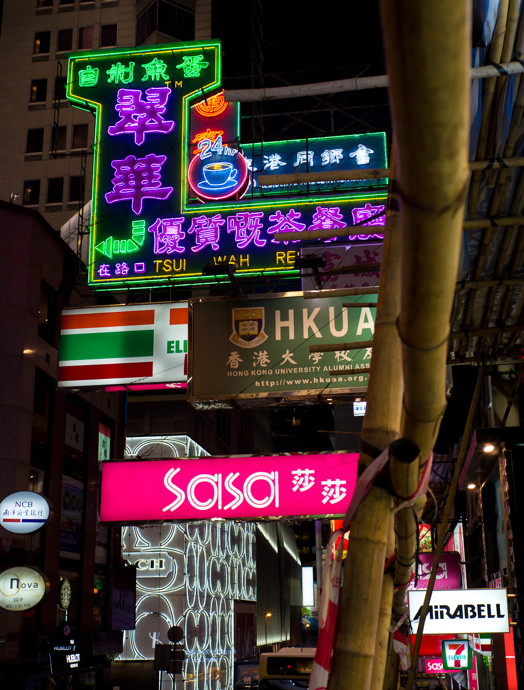 Dozens of neon brand lights in the streets of Hong-Kong at night. Sony NEX-5N