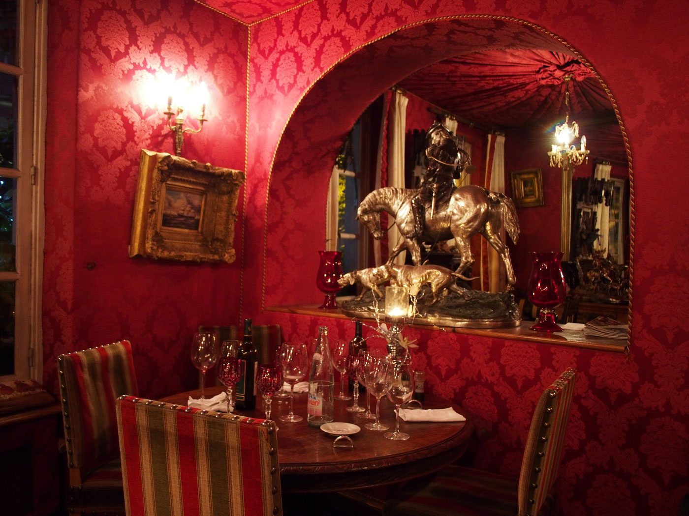 A red interior inside a 500 year old restaurant in Paris, said to be full of ghosts. Olympus OM-D & Panasonic 14/2.5