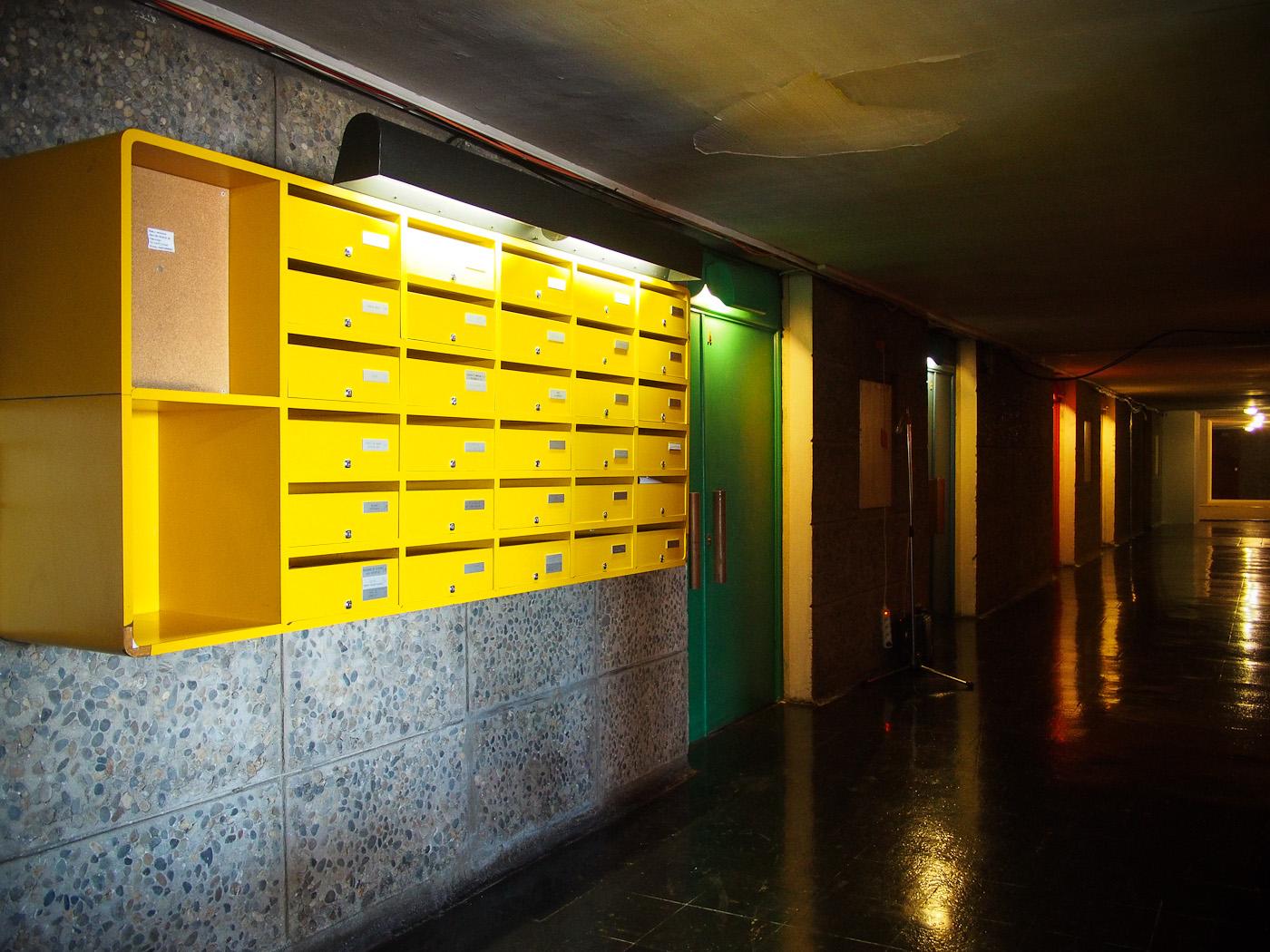 Yellow letterboxes inside Le Corbusier's La Cité Radieuse, Marseilles. Olympus OM-D EM-5