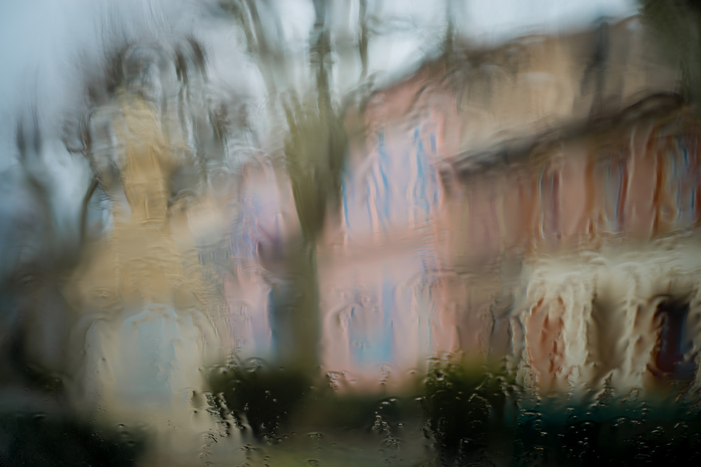 A colourful provence village under the rain from inside a car