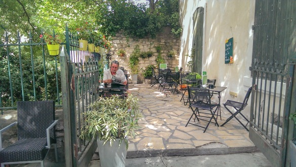 A gentleman reading the papers in the shade in Arles. Picture part of a review of the HTC One camera